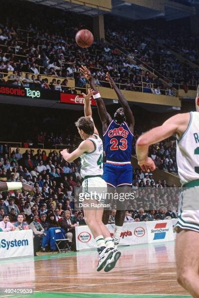 Tyrone Corbin of the Cleveland Cavaliers shoots over Mark Acres of the Boston Celtics during a game played in 1988 at the Boston Garden in Boston...