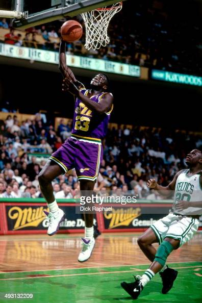 Tyrone Corbin of the Utah Jazz rises for a layup against the Boston Celtics during a game played circa 1994 at the Boston Garden in Boston...