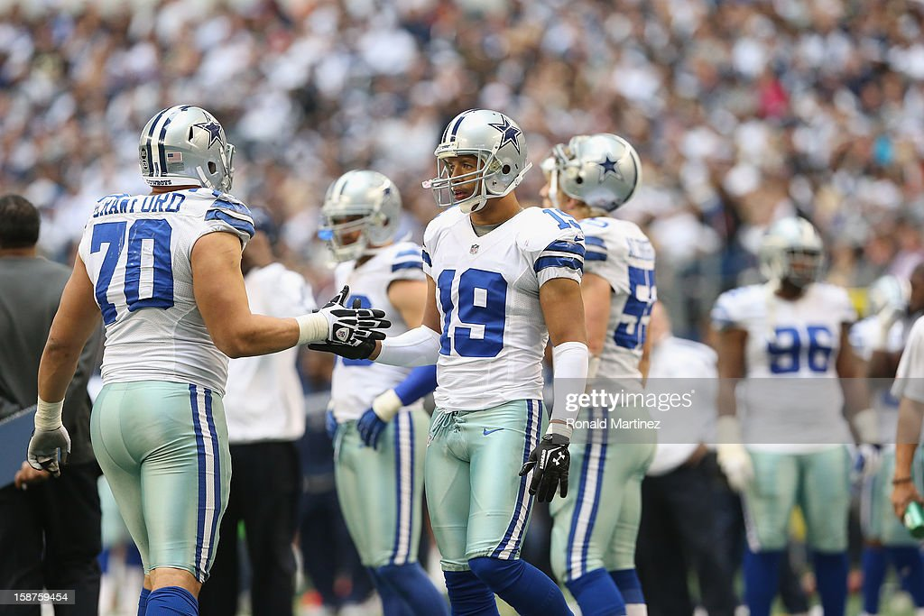 Tyrone Crawford #70 of the Dallas Cowboys and Miles Austin at Cowboys Stadium on December 23, 2012 in Arlington, Texas.