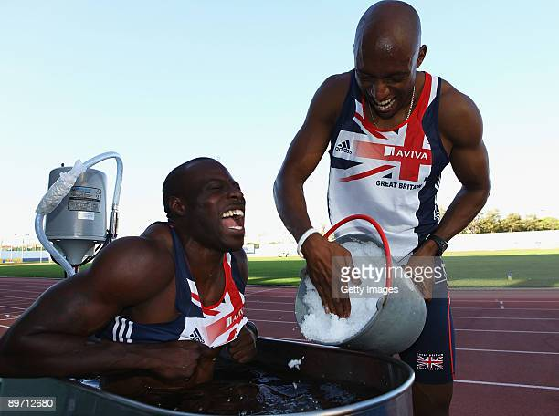 Tyrone Edgar of Great Britain looks on as Marlon Devonish of Great Britain adds ice to the ice bath during a training session at the Aviva GB NI Team...