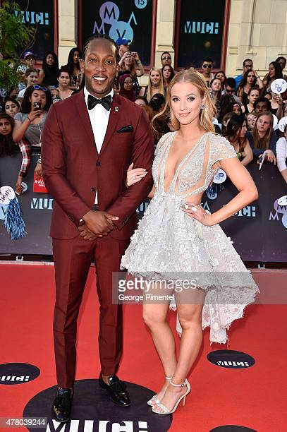 Tyrone Edwards and Liz Trinnear arrive at the 2015 MuchMusic Video Awards at MuchMusic HQ on June 21 2015 in Toronto Canada