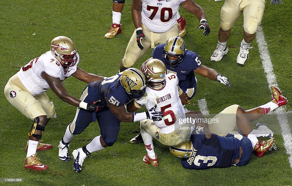 Tyrone Ezell #50, Ejuan Price #5 and Nicholas Grigsby #3 of the Pittsburgh Panthers sack <a gi-track='captionPersonalityLinkClicked' href=/galleries/search?phrase=Jameis+Winston&family=editorial&specificpeople=8772860 ng-click='$event.stopPropagation()'>Jameis Winston</a> #5 of the Florida State Seminoles in the second half during the game on September 2, 2013 at Heinz Field in Pittsburgh, Pennsylvania.