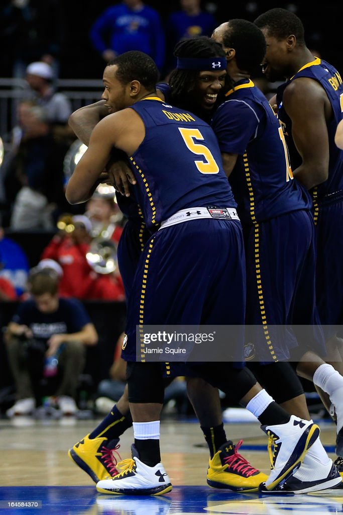 Tyrone Garland (2nd L) #21 of the La Salle Explorers celebrates with teammates including Taylor Dunn #5 after Garland made the game-winning shot to give La Salle a 76-74 win against the Mississippi Rebels during the third round of the 2013 NCAA Men's Basketball Tournament at Sprint Center on March 24, 2013 in Kansas City, Missouri.