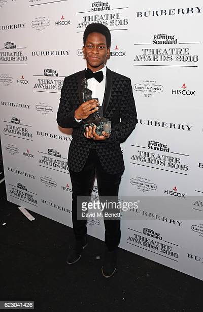 Tyrone Huntley winner of the Emerging Talent Award in partnership with Burberry poses in front of the winners boards at The 62nd London Evening...