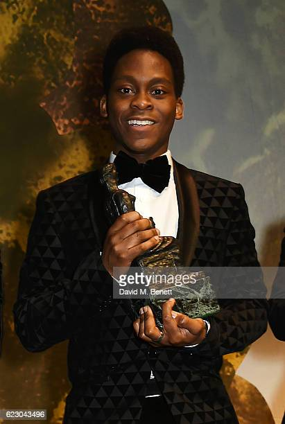 Tyrone Huntley winner of the Emerging Talent Award in partnership with Burberry poses onstage at the 62nd London Evening Standard Theatre Awards...