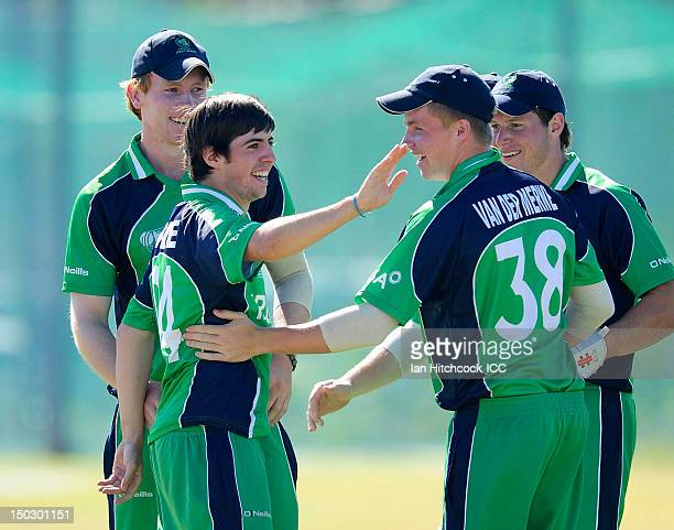 Tyrone Kane of Ireland celebates with team mates the run out of Rajesh Pulami of Nepal during the ICC U19 Cricket World Cup 2012 match between Nepal...