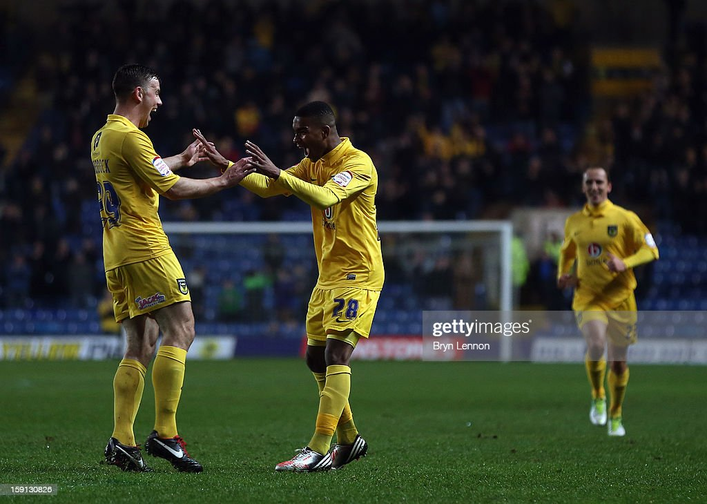 Tyrone Marsh of Oxford United celebrates with team mate Tom Craddock after scoring during the Johnstone's Paint Trophy Southern Section Semi Final between Oxford United and Southend United at the Kassam Stadium on January 8, 2013 in Oxford, England.