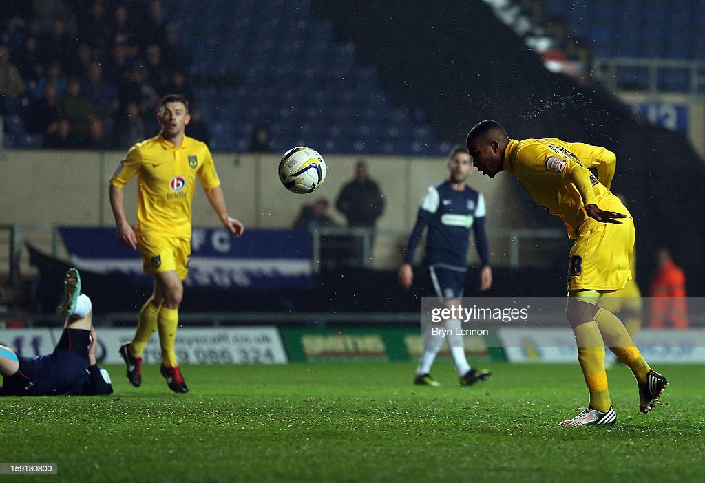Tyrone Marsh of Oxford United scores during the Johnstone's Paint Trophy Southern Section Semi Final between Oxford United and Southend United at the Kassam Stadium on January 8, 2013 in Oxford, England.