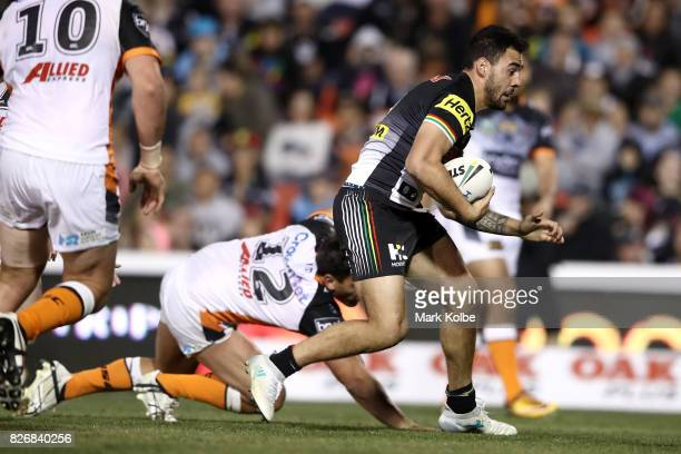 Tyrone May of the Pannthers breaks away to score a try during the round 22 NRL match between the Penrith Panthers and the Wests Tigers at Pepper...