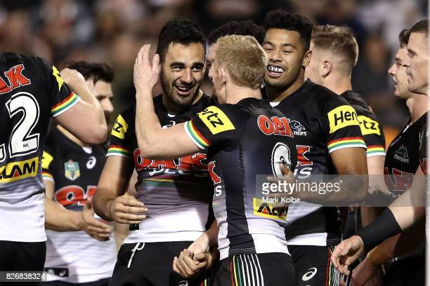 Tyrone May of the Pannthers celebrates with his team mates after scoring a try during the round 22 NRL match between the Penrith Panthers and the...