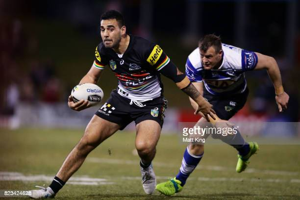 Tyrone May of the Panthers gets away from Josh Morris of the Bulldogs during the round 21 NRL match between the Penrith Panthers and the Canterbury...