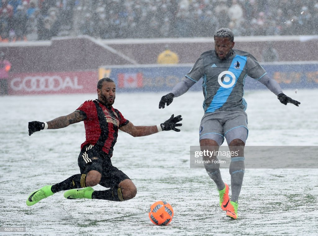 Tyrone Mears #2 of Atlanta United FC challenges Jermaine Taylor #4 of Minnesota United FC for the ball during the first half of the match on March 12, 2017 at TCF Bank Stadium in Minneapolis, Minnesota. Atlanta defeated Minnesota 6-1.