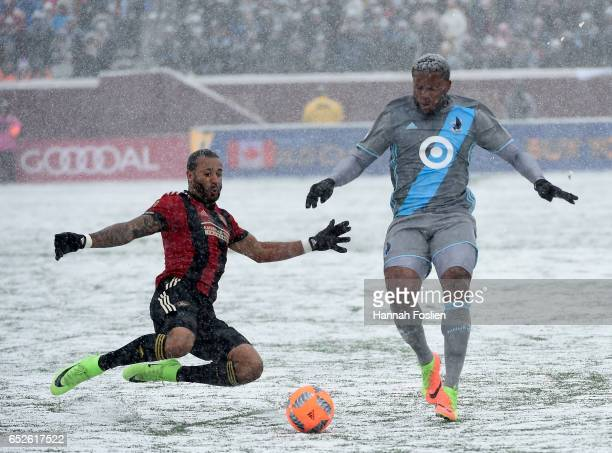 Tyrone Mears of Atlanta United FC challenges Jermaine Taylor of Minnesota United FC for the ball during the first half of the match on March 12 2017...
