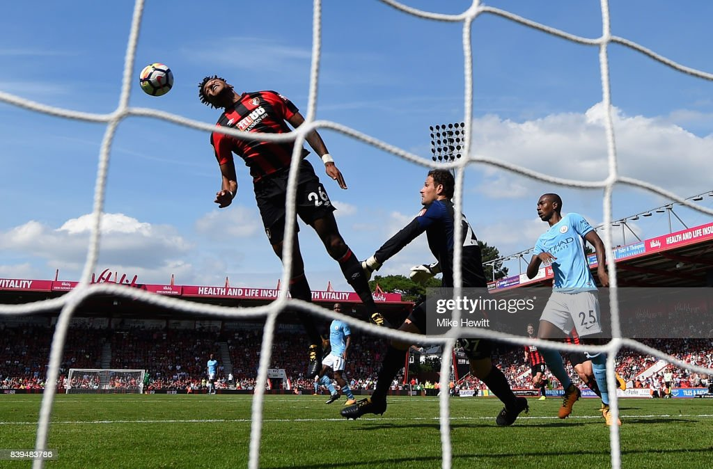 Tyrone Mings of AFC Bournemouth heads the ball off the line during the Premier League match between AFC Bournemouth and Manchester City at Vitality Stadium on August 26, 2017 in Bournemouth, England.