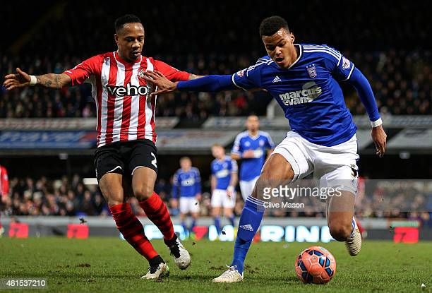 Tyrone Mings of Ipswich battles for the ball with Nathaniel Clyne of Southampton during the FA Cup third round replay match between Ipswich Town and...