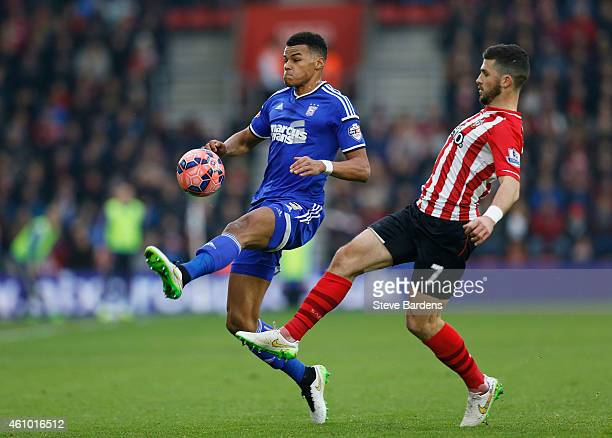 Tyrone Mings of Ipswich is tackled by Shane Long of Southampton during the FA Cup Third Round match between Southampton and Ipswich Town at St Mary's...