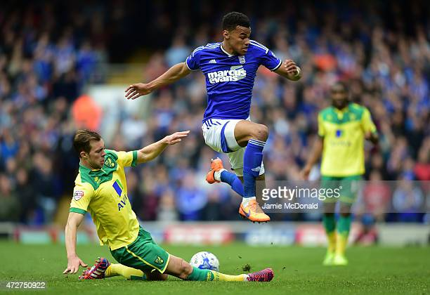 Tyrone Mings of Ipswich skips a challenge by Steven Whittaker of Norwich during the Sky Bet Championship Playoff semifinal first leg match between...