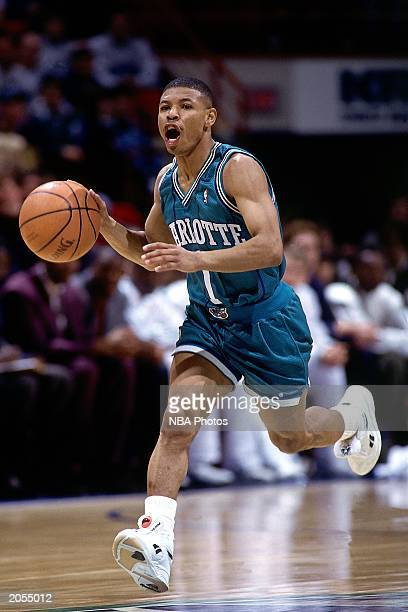 Tyrone Muggsy Bogues of the Charlotte Hornets dribbles upcourt against the Minnesota Timberwolves at the Target Center during a 1993 season NBA game...