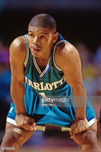 Tyrone 'Muggsy' Bogues of the Charlotte Hornets looks on during the NBA game against the Miami Heat on November 27 in Miami Florida NOTE TO USER User...