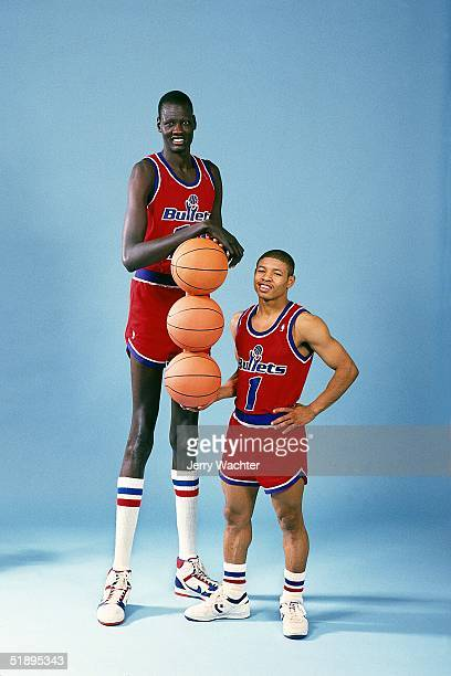 Tyrone 'Muggsy'Boges and Manute Bole of the Baltimore Bullets pose for a portrait portraying the tallest and the Shortest in the NBA game in 1987...