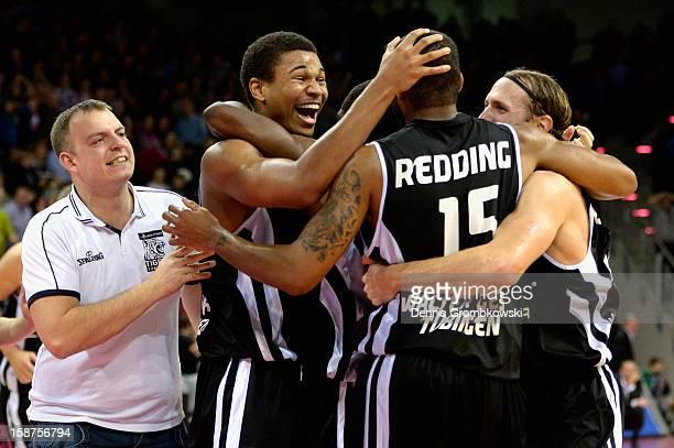 Tyrone Nash of Tuebingen celebrates with teammates after the Beko BBL Basketball Bundesliga match between Telekom Baskets Bonn and WALTER Tigers...
