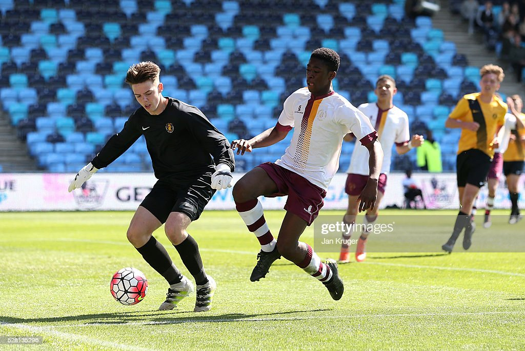 Tyrone Ofori of Thomas Telford School(R) battles with Luke Oswick, Goalkeeper of Samuel Whitbread Academy during the under 16 Schools' Cup final match between Thomas Telford School and Samuel Whitbread Academy at the Academy Training Ground on May 04, 2016 in Manchester, England.