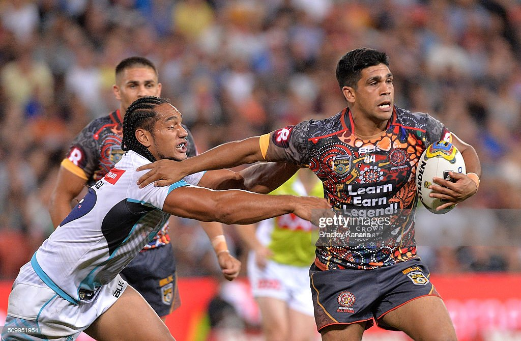 Tyrone Peachey of the Indigenous All Stars attempts to break away from the defence during the NRL match between the Indigenous All-Stars and the World All-Stars at Suncorp Stadium on February 13, 2016 in Brisbane, Australia.