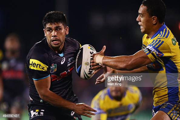 Tyrone Peachey of the Panthers beats the tackle of Will Hopoate of the Eels to score a try during the round 12 NRL match between the Penrith Panthers...