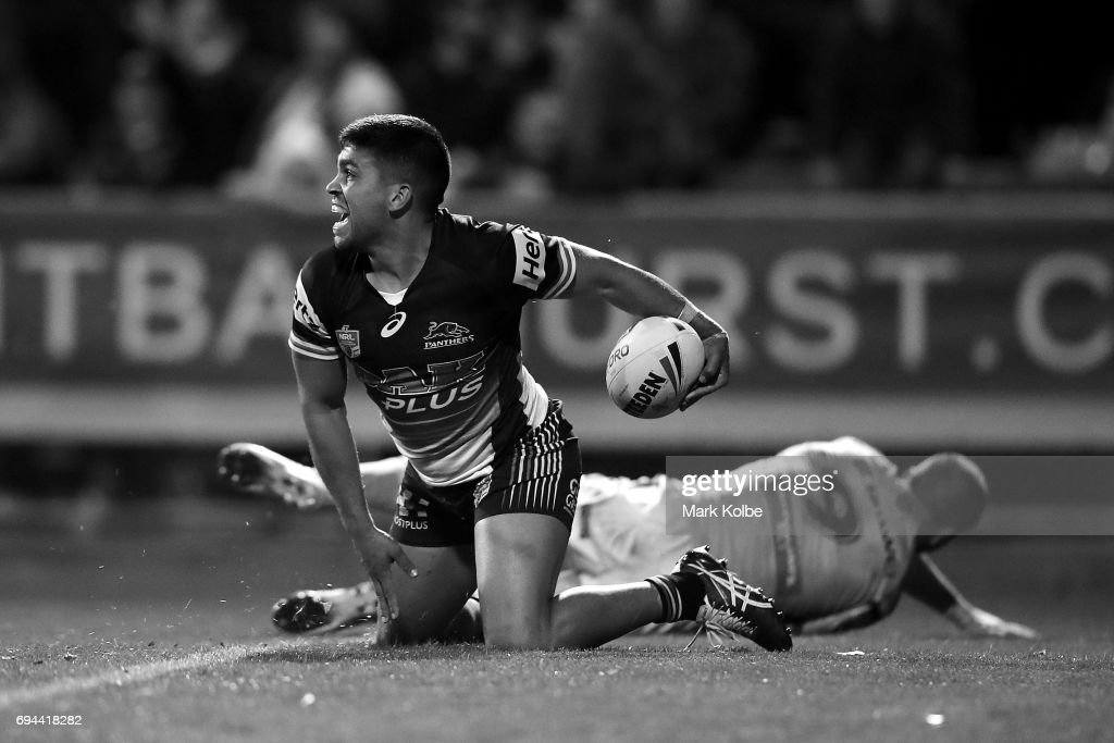 Tyrone Peachey of the Panthers celebrates scoring the match winning try during the round 14 NRL match between the Penrith Panthers and the Canberra Raiders at Carrington Park on June 10, 2017 in Bathurst, Australia.
