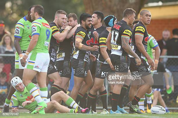 Tyrone Peachey of the Panthers celebrates with his team mates after scoring a try during the round nine NRL match between the Penrith Panthers and...