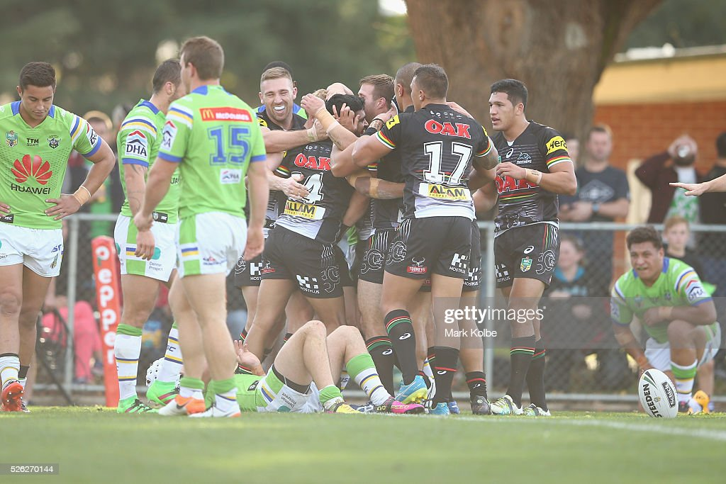Tyrone Peachey of the Panthers celebrates with his team mates after scoring a try during the round nine NRL match between the Penrith Panthers and the Canberra Raiders at Carrington Park on April 30, 2016 in Bathurst, Australia.