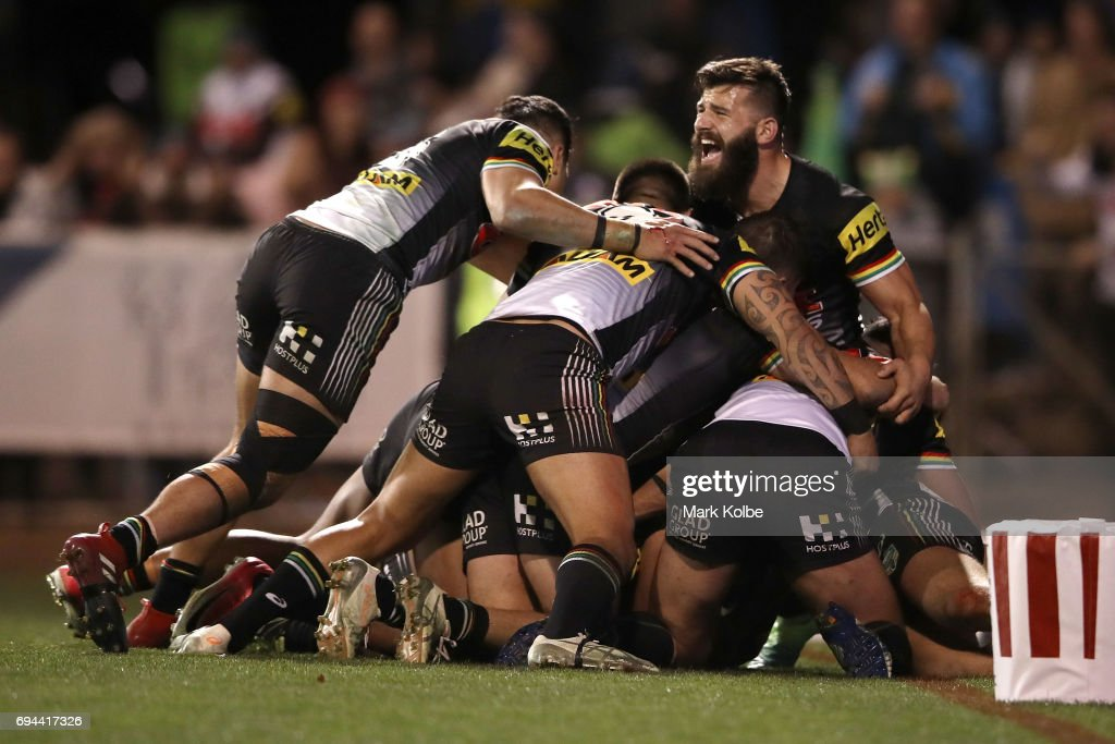Tyrone Peachey of the Panthers celebrates with his team mates after scoring the match winning try during the round 14 NRL match between the Penrith Panthers and the Canberra Raiders at Carrington Park on June 10, 2017 in Bathurst, Australia.