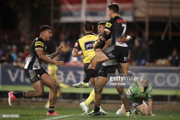 Tyrone Peachey of the Panthers celebrates with his team mates Waqa Blake and Nathan Cleary of the Panthers after scoring the match winning try during...
