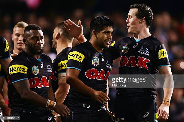 Tyrone Peachey of the Panthers celebrates with team mates after scoring a try during the round 12 NRL match between the Penrith Panthers and the...