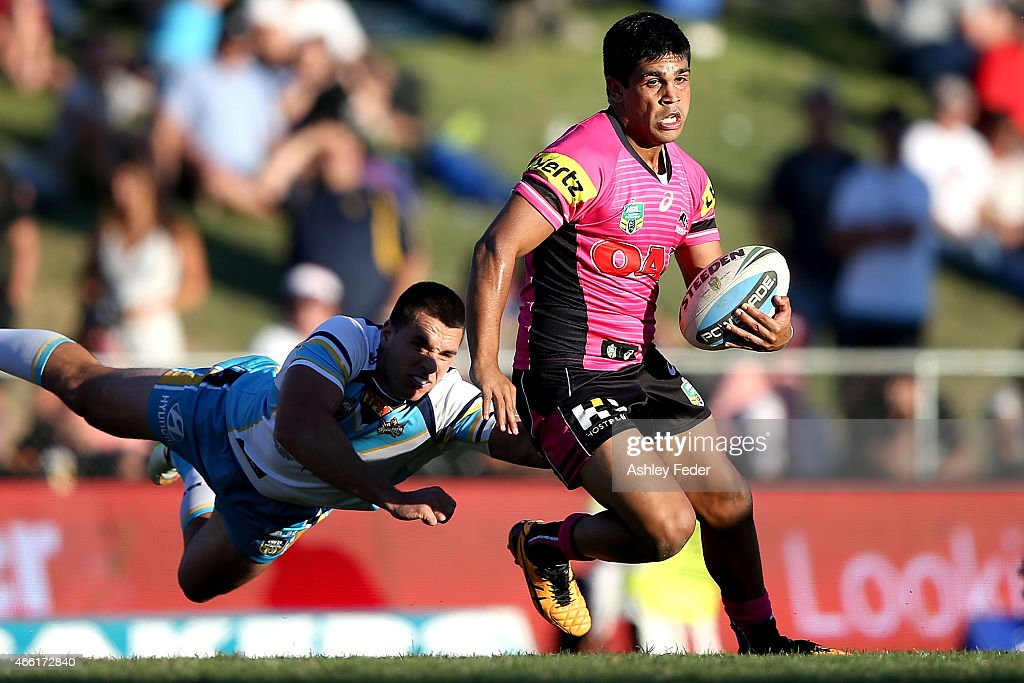 Tyrone Peachey of the Panthers is tackled by the Titans defence during the round two NRL match between the Penrith Panthers and the Gold Coast Titans...