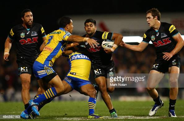 Tyrone Peachey of the Panthers is tackled during the round 12 NRL match between the Penrith Panthers and the Parramatta Eels at Sportingbet Stadium...