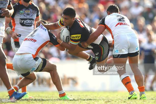 Tyrone Peachey of the Panthers is tackled during the round two NRL match between the Wests Tigers and the Penrith Panthers at Campbelltown Sports...