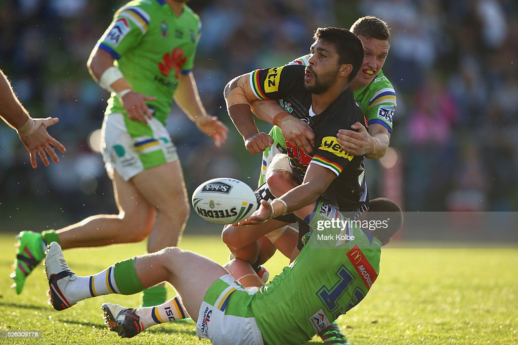Tyrone Peachey of the Panthers passes as he is tackled during the round nine NRL match between the Penrith Panthers and the Canberra Raiders at Carrington Park on April 30, 2016 in Bathurst, Australia.
