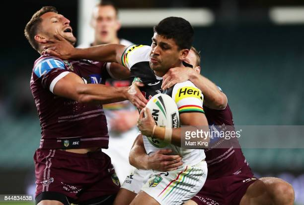 Tyrone Peachey of the Panthers puts a fend on Lewis Brown of the Sea Eagles during the NRL Elimination Final match between the Manly Sea Eagles and...