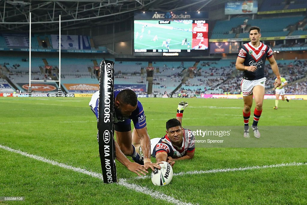 Tyrone Phillips of the Bulldogs scores a try during the round 11 NRL match between the Canterbury Bulldogs and the Sydney Roosters at ANZ Stadium on...