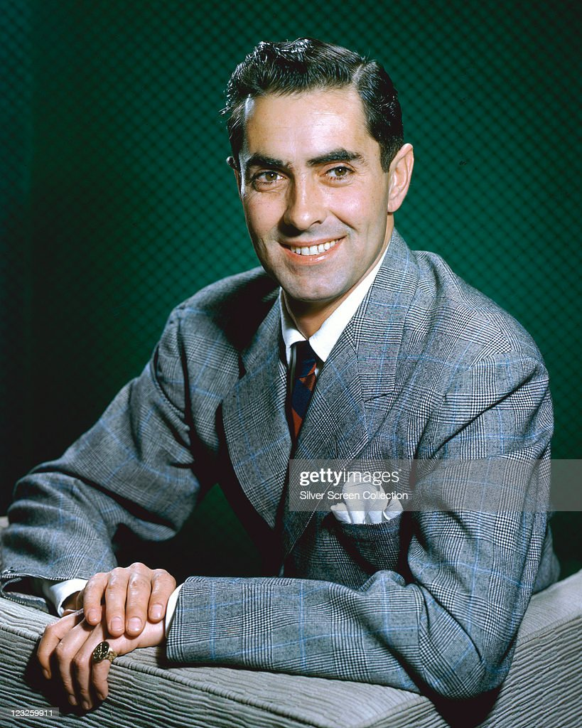 <a gi-track='captionPersonalityLinkClicked' href=/galleries/search?phrase=Tyrone+Power&family=editorial&specificpeople=94168 ng-click='$event.stopPropagation()'>Tyrone Power</a> (1914-1958), US actor, wearing a grey tweed jacket, with a white shirt and a red-and-blue striped tie, smiling in a studio portrait against a green background, circa 1950.
