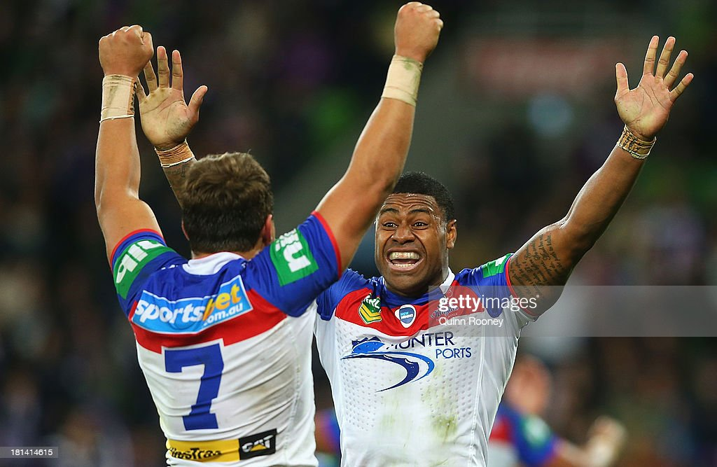 Tyrone Roberts and Kevin Naiqama of the Knights celebrate winning the NRL Second Semi Final match between the Melbourne Storm and the Newcastle Knights at AAMI Park on September 21, 2013 in Melbourne, Australia.