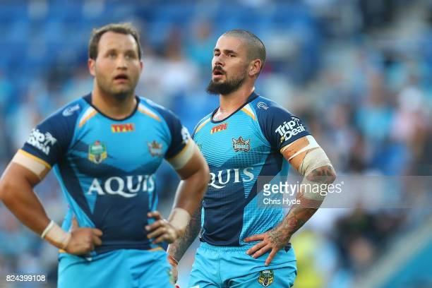 Tyrone Roberts and Nathan Peats of the Titans look on during the round 21 NRL match between the Gold Coast Titans and the Wests Tigers at Cbus Super...