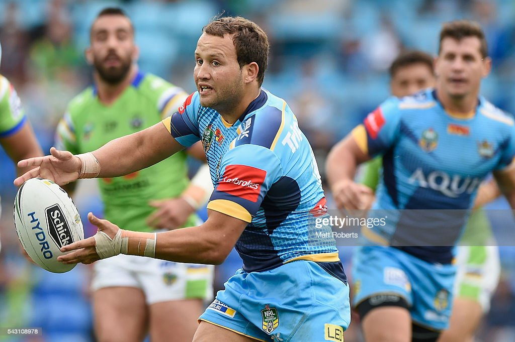 Tyrone Roberts of the Titans passes the ball during the round 16 NRL match between the Gold Coast Titans and the Canberra Raiders at Cbus Super Stadium on June 26, 2016 in Gold Coast, Australia.