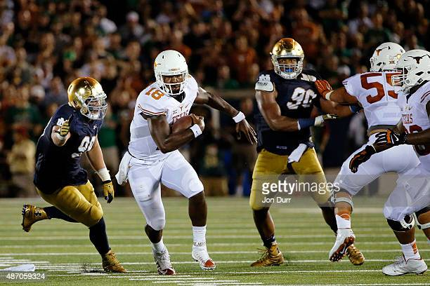 Tyrone Swoopes of the Texas Longhorns avoids the tackle of Jerry Tillery of the Notre Dame Fighting Irish during the second quarter at Notre Dame...