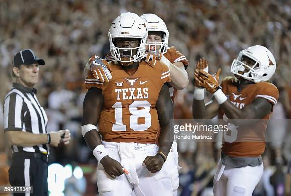 Tyrone Swoopes of the Texas Longhorns celebrates with teammates after scoring a touchdown in the first overtime against the Notre Dame Fighting Irish...