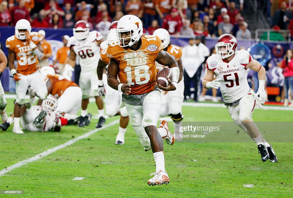 Tyrone Swoopes of the Texas Longhorns runs for a 9yard touchdown in the first half of their game against the Arkansas Razorbacks at the AdvoCare V100...