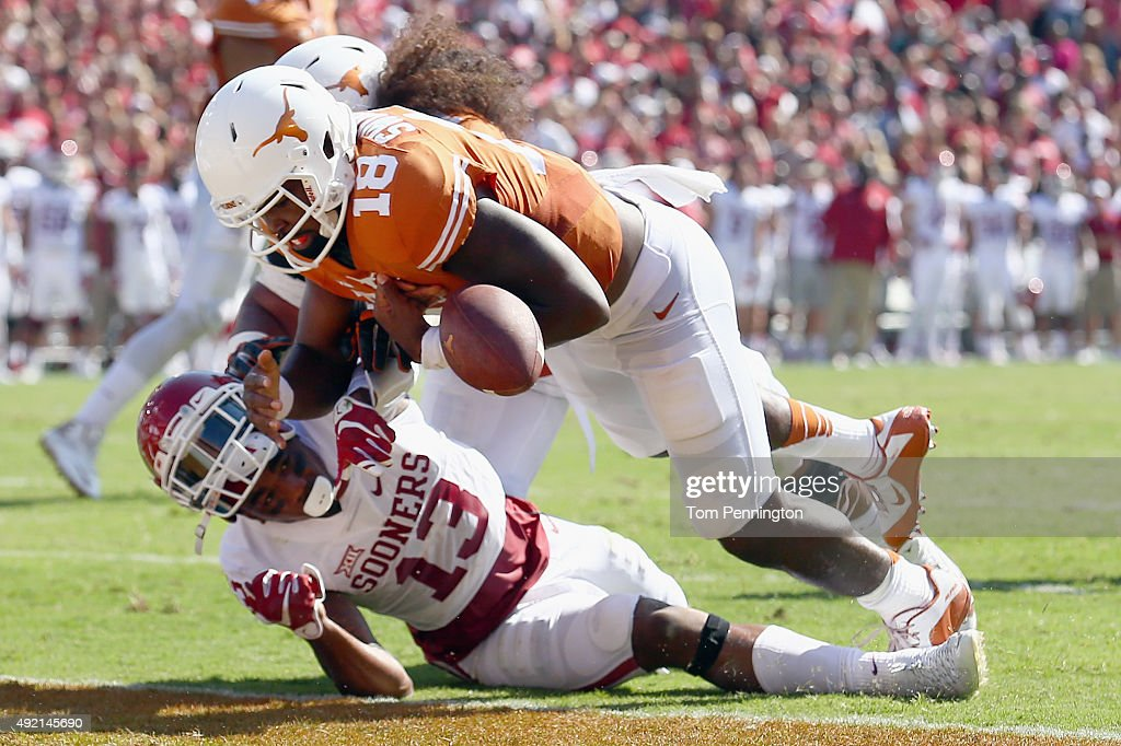 Tyrone Swoopes of the Texas Longhorns scores a touchdown against Ahmad Thomas of the Oklahoma Sooners in the first quarter during the ATT Red River...