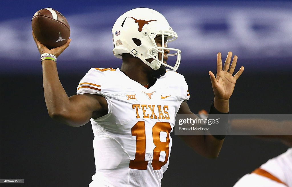 Tyrone Swoopes of the Texas Longhorns throws against the UCLA Bruins in the second quarter at ATT Stadium on September 13 2014 in Arlington Texas