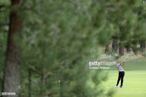 Tyrone Van Aswegen of South Africa plays his second shot on the fifth hole during the third round of the Barracuda Championship at Montreux Country...